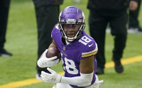 Justin Jefferson of the Vikings turns up field