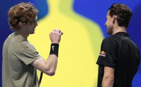 ATP players Andrey Rublev of Russia, left,celebrates defeating Dominic Thiem
