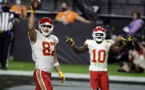 Kansas City Chiefs Travis Kelce (87) and Tyreek Hill (10) celebrating after a touchdown.