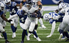 Tennessee Titans running back Derrick Henry running with the ball during a game.