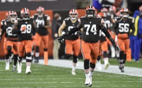 Cleveland Browns offensive tackle Chris Hubbard and his teammates run onto the field before a game.
