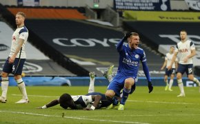 Leicester's Jamie Vardy reacts and celebrates after Tottenham scored on themselves.