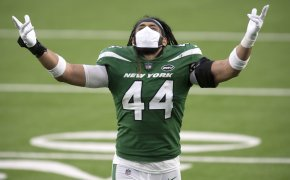Harvey Langi throws hands in the air to celebrate