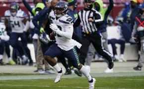 Seattle Seahawks running back Carlos Hyde running the ball during a game.