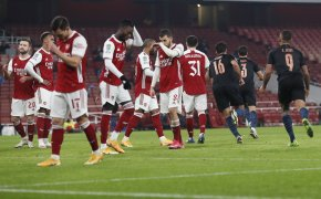 Arsenal players reacting to being scored on during a game against Manchester City