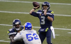Seattle Seahawks quarterback Russell Wilson throwing a pass in a game.