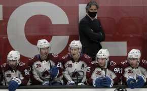 Colorado head coach Jared Bednar behind players on the bench