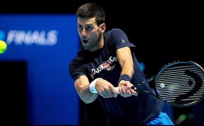 Novak Djokovic about to hit a bkackhand