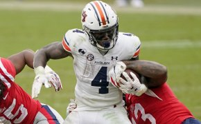 Auburn running back Tank Bigsby fighting through a tackle