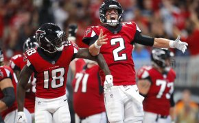 Calvin Ridley and Matt Ryan of the Atlanta Falcons celebrating on the field.