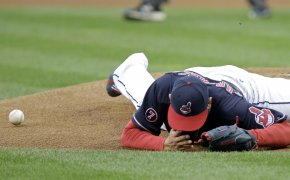 Cleveland Indians pitcher Carlos Carrasco falls to the ground
