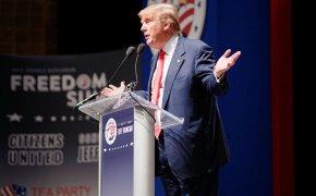 Donald Trump gesturing on stage