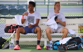 Felix Auger-Aliassime and Denis Shapovalov sitting beside each other