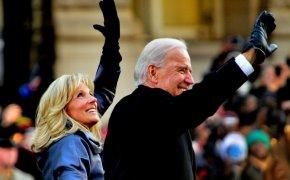 Joe and Jill Biden smiling and waving to a crowd
