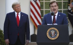 My Pillow CEO Mike Lindell speaks at a press conference as President Donald Trump listens