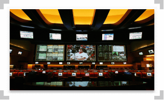 Multiple televisions displaying sports games in a retail sportsbook location