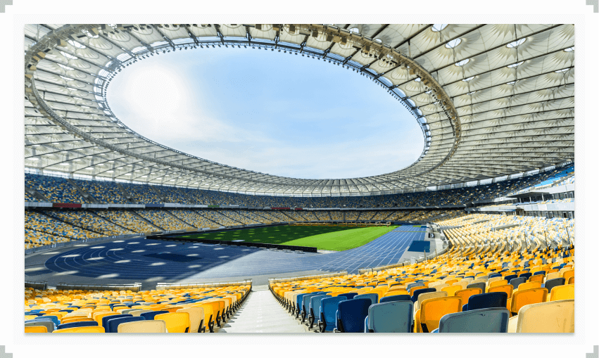 Large empty stadium with open roof