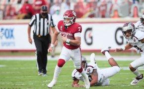 Spencer Rattler of the Oklahoma Sooners running the ball.