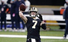 New Orleans Saints quarterback Taysom Hill warming up