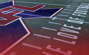 image of the xfl logo painted on a football field