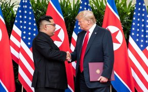 Kim Jong-un shaking hands with Donald Trump