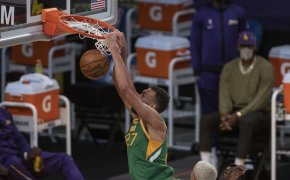 Rudy Gobert dunking the ball during a NBA game.