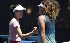 Naomi Osaka and Hsieh Su-Wei engaging at the net after their match.