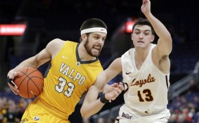 Valparaiso's John Kiser driving to the basket against Loyola's Clayton Custer in a NCAA men's basketball game.