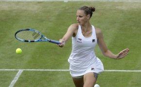 Karolina Pliskova hitting a return during a tennis match.