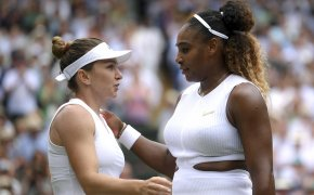 Simona Halep and Serena Williams going in for a hug on the court right after a match between the two.