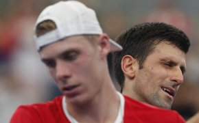 A close up of Novak Djokovic and Denis Shapovalov during a match at the ATP Cup.