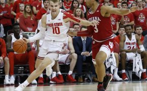 Ohio State's Justin Ahrens dribbling the ball past Indiana's Justin Smith during a NCAA men's basketball game.