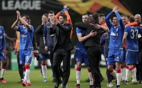 Rangers' players and manager celebrating after winning a match.