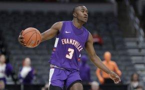 Evansville's Jawaun Newton brings the ball down the court