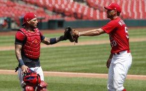 Adam Wainwrigh and Yadier Molina fist bump