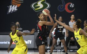 A'ja Wilson is defended by two Seattle players