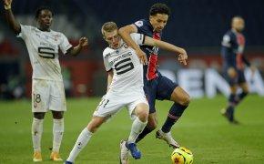 Adrien Truffert and Marquinhos fight for possession of ball