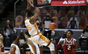 Yves Pons hanging on rim after a dunk
