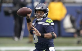 Seattle Seahawks quarterback Russell Wilson throwing a football during a NFL game.
