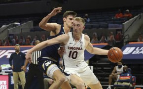 Virginia forward Sam Hauser dribbling the ball during a NCAA basketball game against Notre Dame.