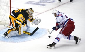 Pittsburgh Penguins goaltender Tristan Jarry blocking a shot by New York Rangers' Tony DeAngelo in a shootout.