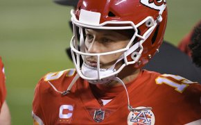 A close up shot of Patrick Mahomes on the sidelines during a football game.