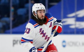 New York Rangers forward Mika Zibanejad skating on the ice during an NHL game.