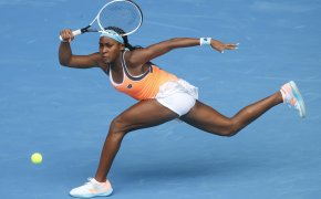 Cori Gauff of the United States stretching for a forehand return during a tennis match.
