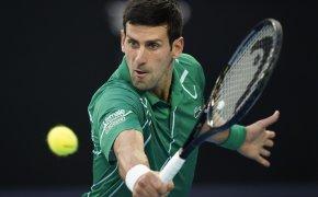 Novak Djokovic hitting ball with his backhand
