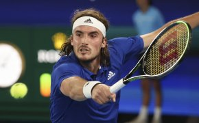 Greece's Stefanos Tsitsipas hitting a backhand during a match at the 2021 ATP Cup.