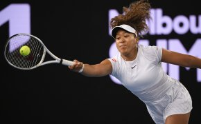 Japan's Naomi Osaka stretches for a forehand return during a match.
