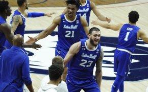 Seton Hall players reacting after winning a NCAA men's basketballl game.