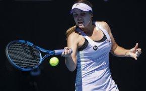 Sofia Kenin hitting a forehand return in a match at the Australian Open.