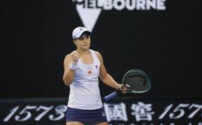 Ashleigh Barty celebrating a win on the court with a fistpump at the 2021 Australian Open.